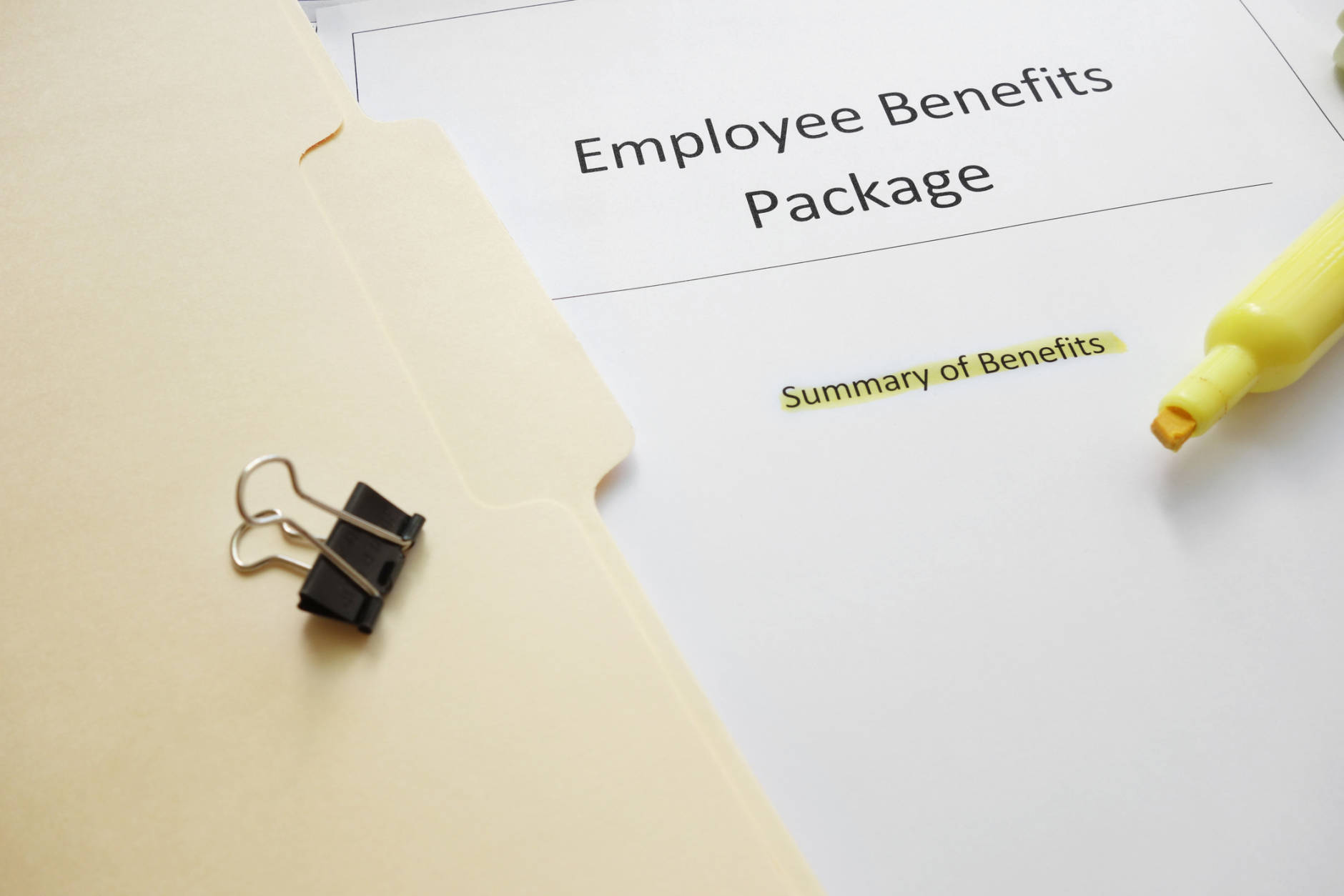 Employee benefits documents with highlighted text