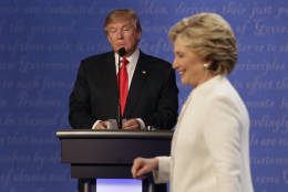 FILE - In this Oct. 19, 2016 file photo, Republican presidential nominee Donald Trump waits behind his podium as Democratic presidential nominee Hillary Clinton makes her way off the stage following the third presidential debate at UNLV in Las Vegas. (AP Photo/David Goldman)