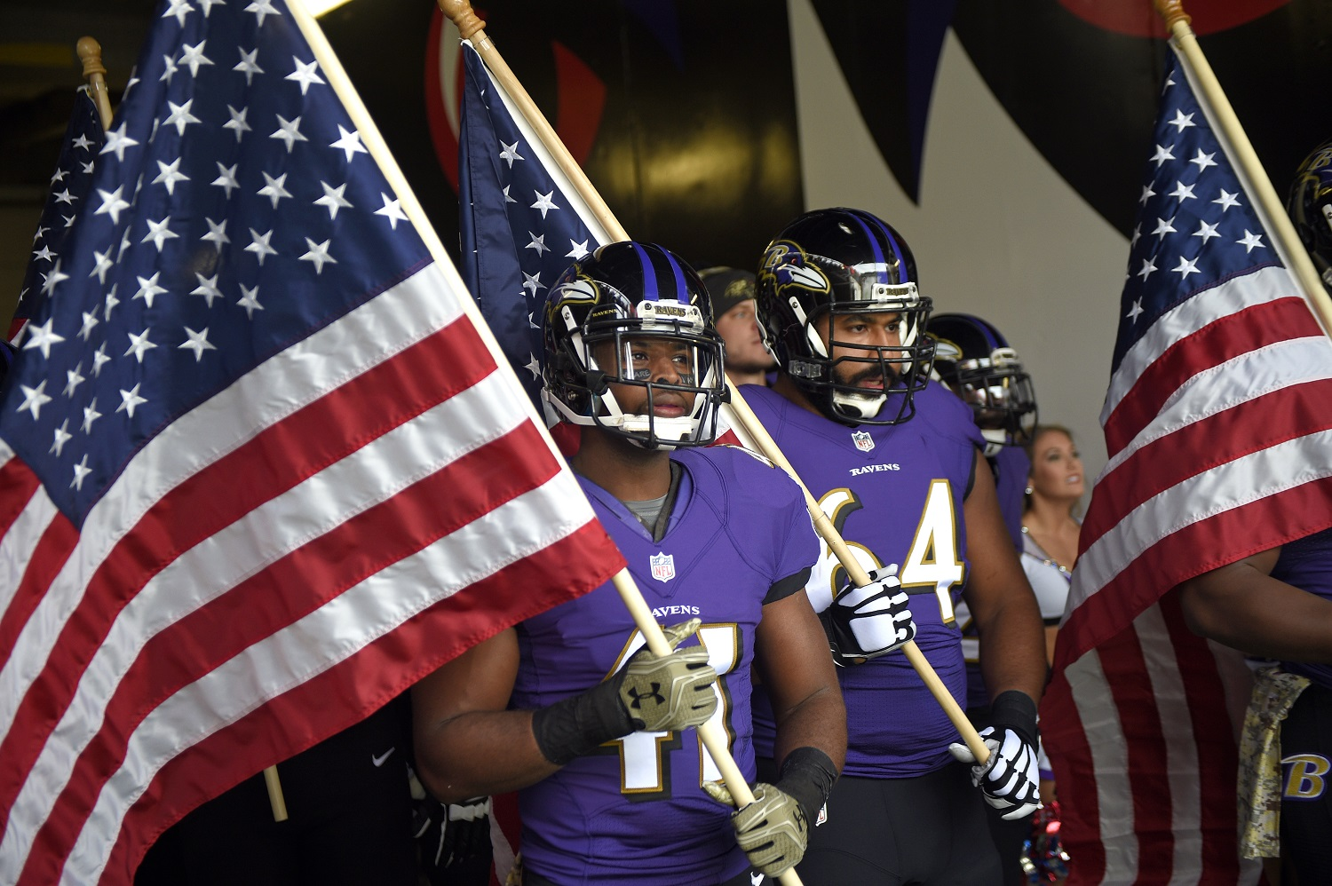 Baltimore Ravens cornerback Anthony Levine (41) and offensive guard John Urschel (64) wait to run onto the field with United States flags before an NFL football game against the Pittsburgh Steelers, Sunday, Nov. 6, 2016, in Baltimore. (AP Photo/Nick Wass)