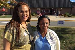 """I'm happy tonight will be the end to all this,"" said Kathleen Martin, of Northern Virginia precinct 408. Next to her, Debrah Allotey said, ""God will choose the best person."" (WTOP/Kristi King)"