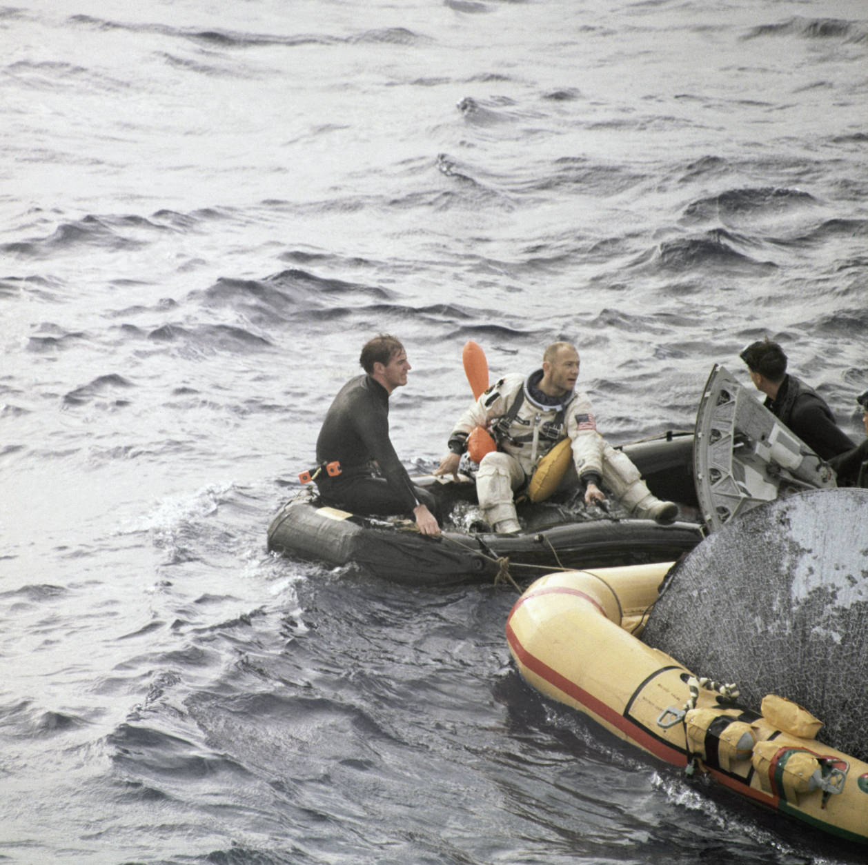Edwin E. Aldrin Jr. (Buzz), and James A. Lovell Jr, pictures with space capsule in the water and the helicopter recovery of the astronauts, shown in an undated photo. (AP Photo)