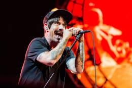 FILE - In this July 30, 2016 file photo, Anthony Kiedis of Red Hot Chili Peppers performs at Lollapalooza in Chicago. The band will perform at the Los Angeles Memorial Coliseum before the Rams take on the Seattle Seahawks. The Rams moved to Los Angeles this season since leaving for St. Louis in 1994. (Photo by Amy Harris/Invision/AP, File)