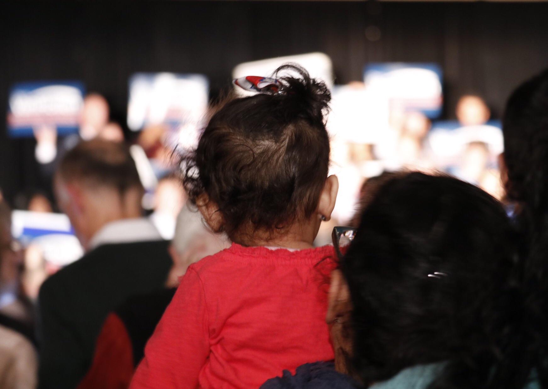 A toddler gets a better view of Van Hollen. (WTOP/Kate Ryan)