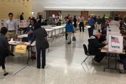 Voters cast their ballots at a Fairfax County polling site in Langley, Virginia on Tuesday, Nov. 8, 2016. Eighty percent of the county's registered voters had cast a ballot as of 6 p.m. (WTOP/Kristi King)