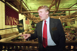File-This June 7, 1995, file photo shows real estate magnate Donald Trump posing for photos above the floor of the New York Stock Exchange after taking his flagship Trump Plaza Casino public in New York City. Trump's business losses in 1995 were so large that they could have allowed him to avoid paying federal income taxes for as many as 18 years, according to records obtained by The New York Times.  (AP Photo/Kathy Willens, File)