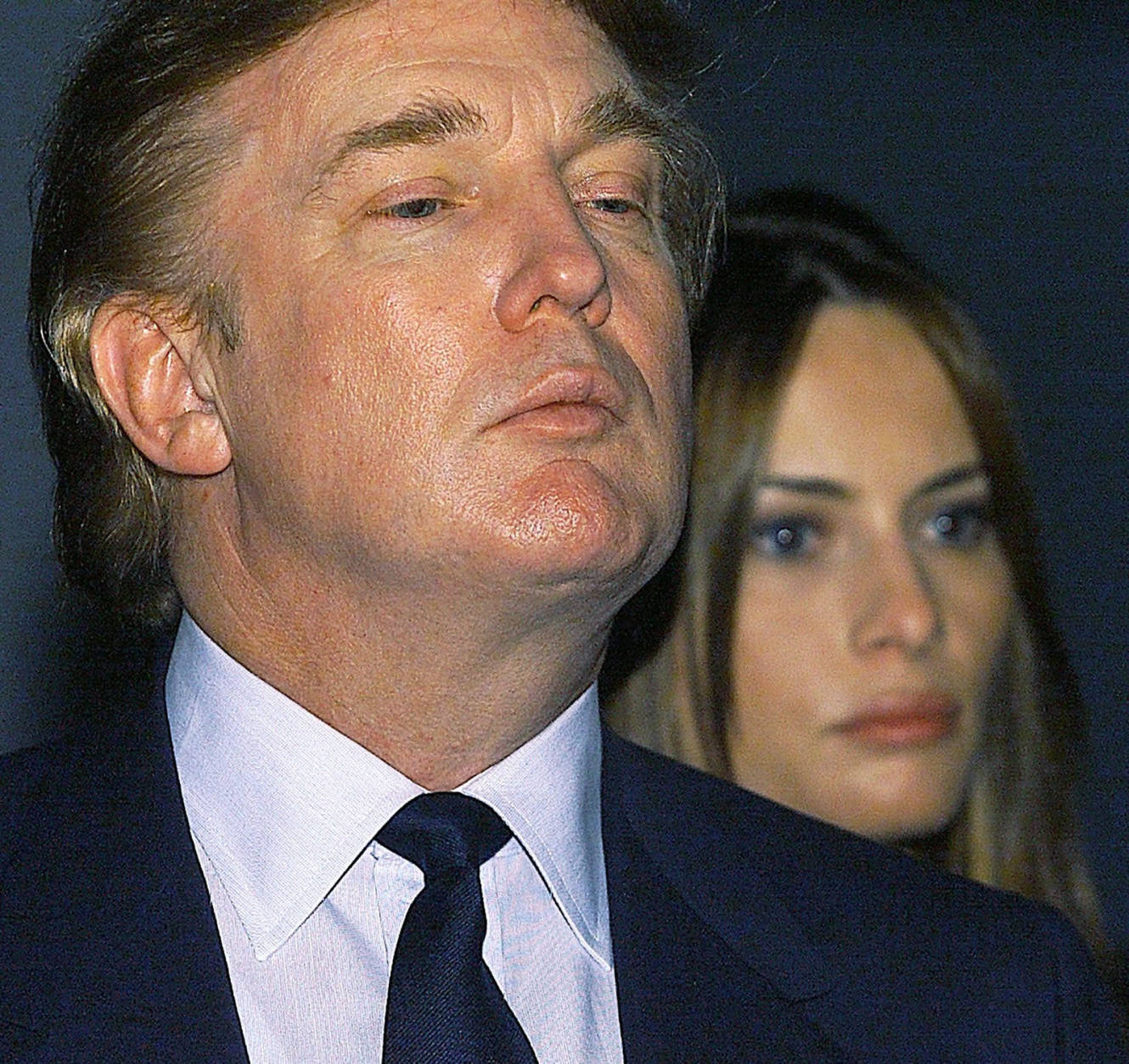 New York billionaire real estate tycoon Donald Trump and his 26-year-old girlfriend model Melania Knauss listen to recorded Nazi propaganda as they tour the Museum of Tolerance in Los Angeles on Tuesday, Dec. 7, 1999. Trump, who is contemplating a presidential run is in the Southern California area to address Reform Party leaders and to give a motivational speech in Orange County. (AP Photo/Damian Dovarganes)