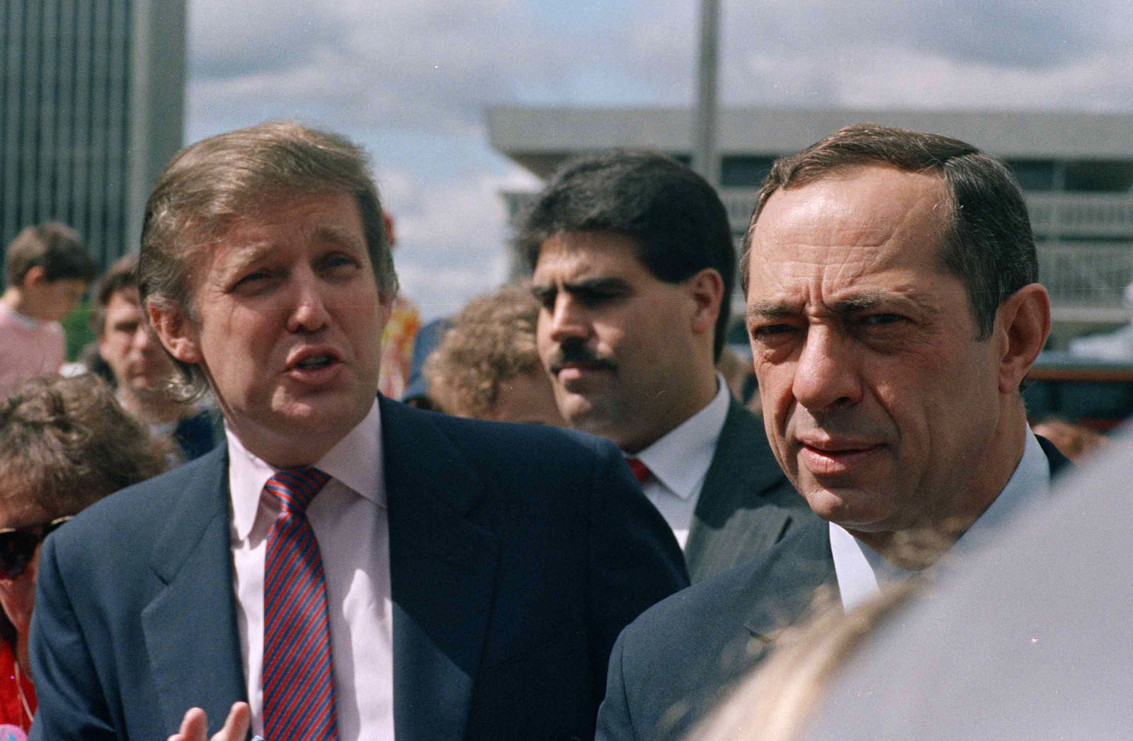Developer Donald Trump and New York State Gov. Mario Cuomo get together before the start of the Tour De Trump bicycle race in Albany, New York on May 6, 1989. (AP Photo/Alan Soloman)