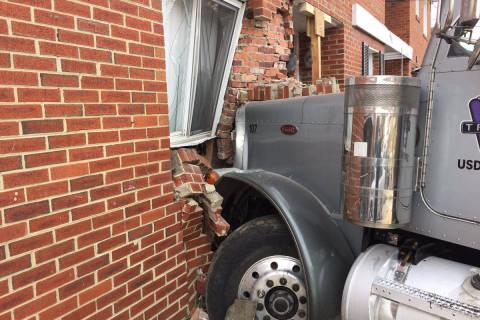 Dump truck crashes into Oxon Hill home; children injured