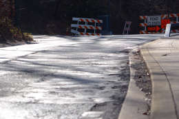 A section of Beach Drive near Peirce Mill has been patched over and over again. The road has outlasted its service life and will be rebuilt over the next three years. (WTOP/Dave Dildine)
