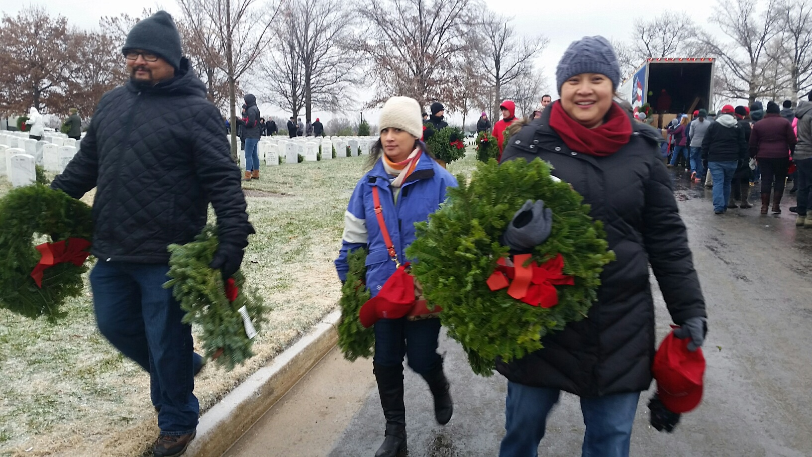 The opening ceremony of the Wreaths Across America ceremony had to be canceled Saturday morning due to freezing rain, but 44,000 volunteers still showed up to participate Saturday morning, Dec. 16, 2016 at Arlington National Cemetery. (WTOP/Kathy Stewart)