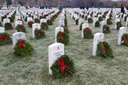 A sea of wreaths with red ribbons lay on head stones at Arlington National Cemetery on a frosty morning when the Wreaths Across America ceremony took place for the 25th year on Dec. 17, 2016. (WTOP Kathy Stewart)