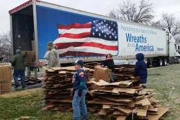 Empty boxes lay outside a truck that helped carry 245,000 remembrance wreaths that were placed at Arlington National Cemetery to honor veterans Saturday,  Dec. 17, 2016. (WTOP Kathy Stewart)