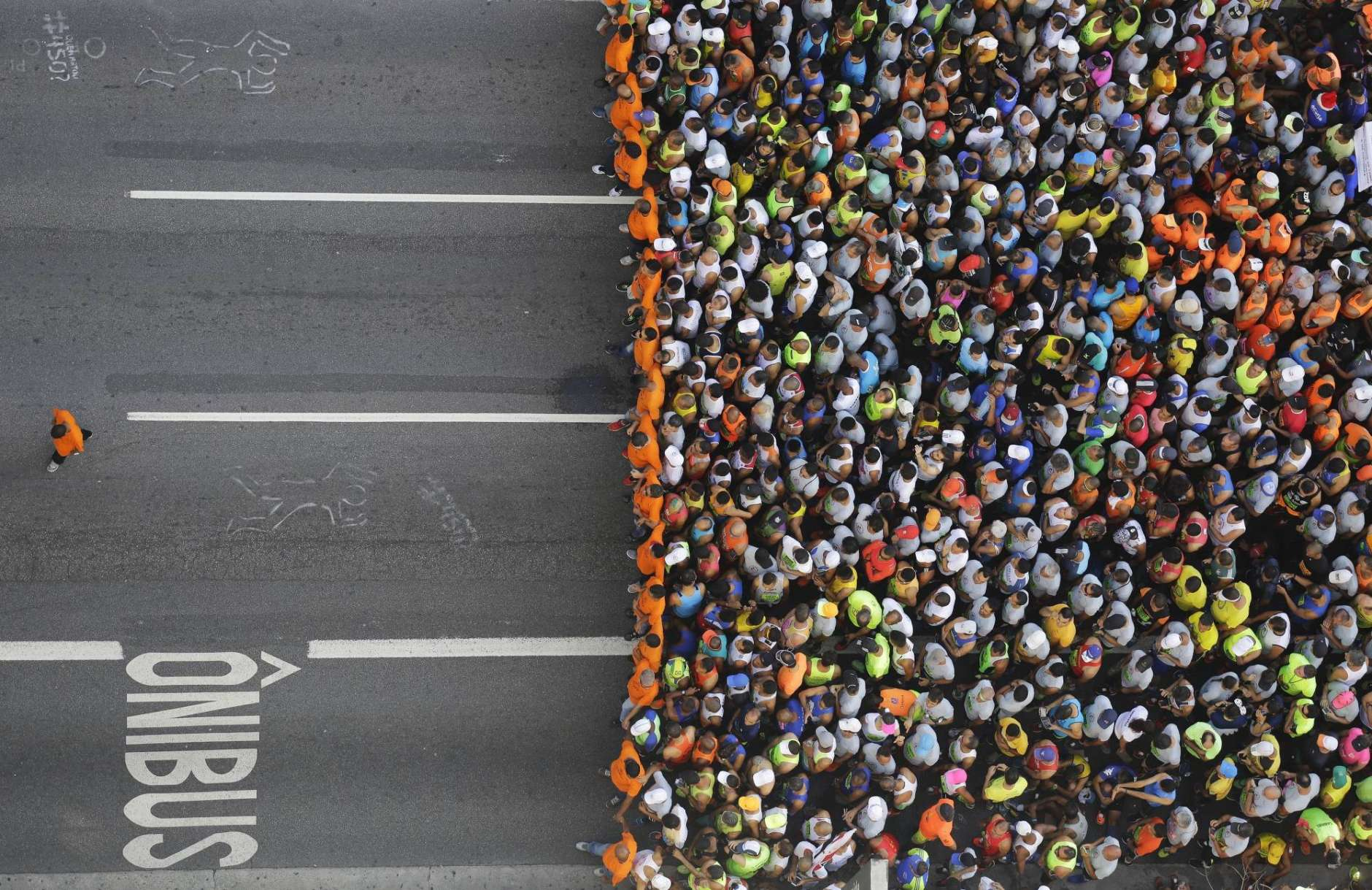 Runners wait to compete in the Sao Silvestre race in Sao Paulo, Brazil, Saturday, Dec. 31, 2016. The 15-kilometer race is held annually on New Year's Eve. (AP Photo/Nelson Antoine)