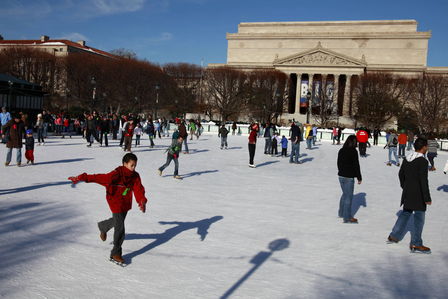 People ice skate at the National Gallery of Art's Sculpture Garden in Washington, on Thursday, Dec. 24, 2009.  (AP Photo/Jacquelyn Martin)