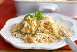 This Oct. 31, 2011 photo shows creamy crab and rice casserole in Concord, N.H.  This dish takes the flavors of a creamy crab dip and turns it into a meal. It serves 16 as a hearty dinner, but can feed many more at a potluck, where diners tend to take smaller portions of each dish.   (AP Photo/Matthew Mead)