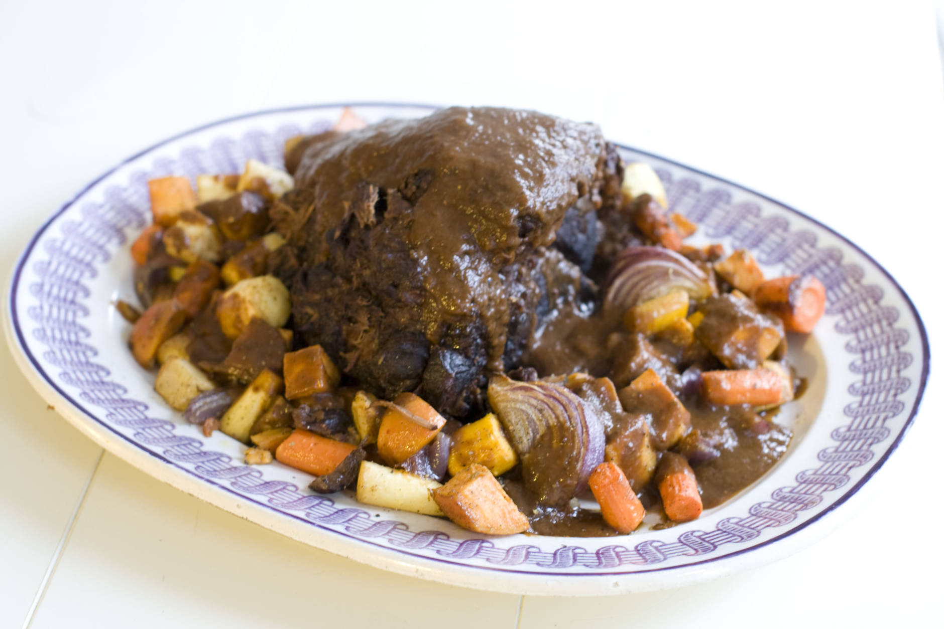 This Nov. 11, 2013 photo shows holiday pot roast with spiced root vegetables in Concord, N.H. This recipe is designed to give maximum flavor with minimum labor. (AP Photo/Matthew Mead)
