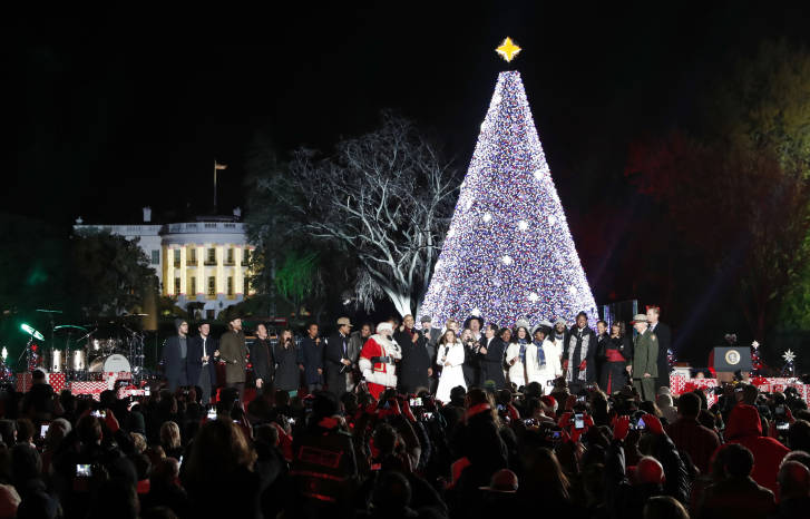 with michelle obama and daughter sasha sing with santa claus and others during the lighting ceremony for the 2016 national christmas tree is seen - Christmas Tree Lighting