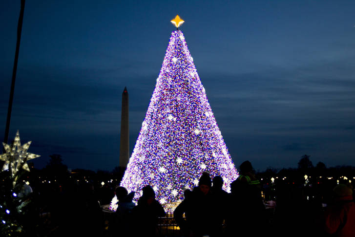 visitors look at the national christmas tree with the washington monument in the background on the ellipse near the white house in washington saturday - Christmas In Washington