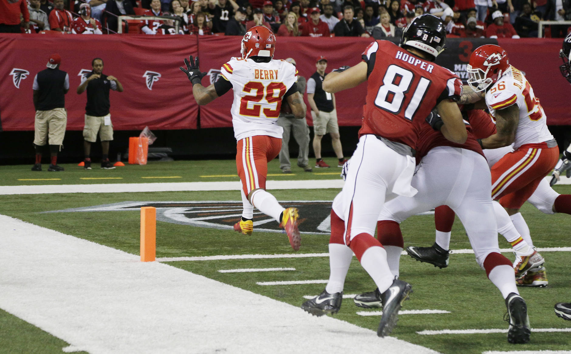 Kansas City Chiefs strong safety Eric Berry (29) scores a touchdown on an interception against the Atlanta Falcons during the first half of an NFL football game, Sunday, Dec. 4, 2016, in Atlanta. (AP Photo/Chuck Burton)