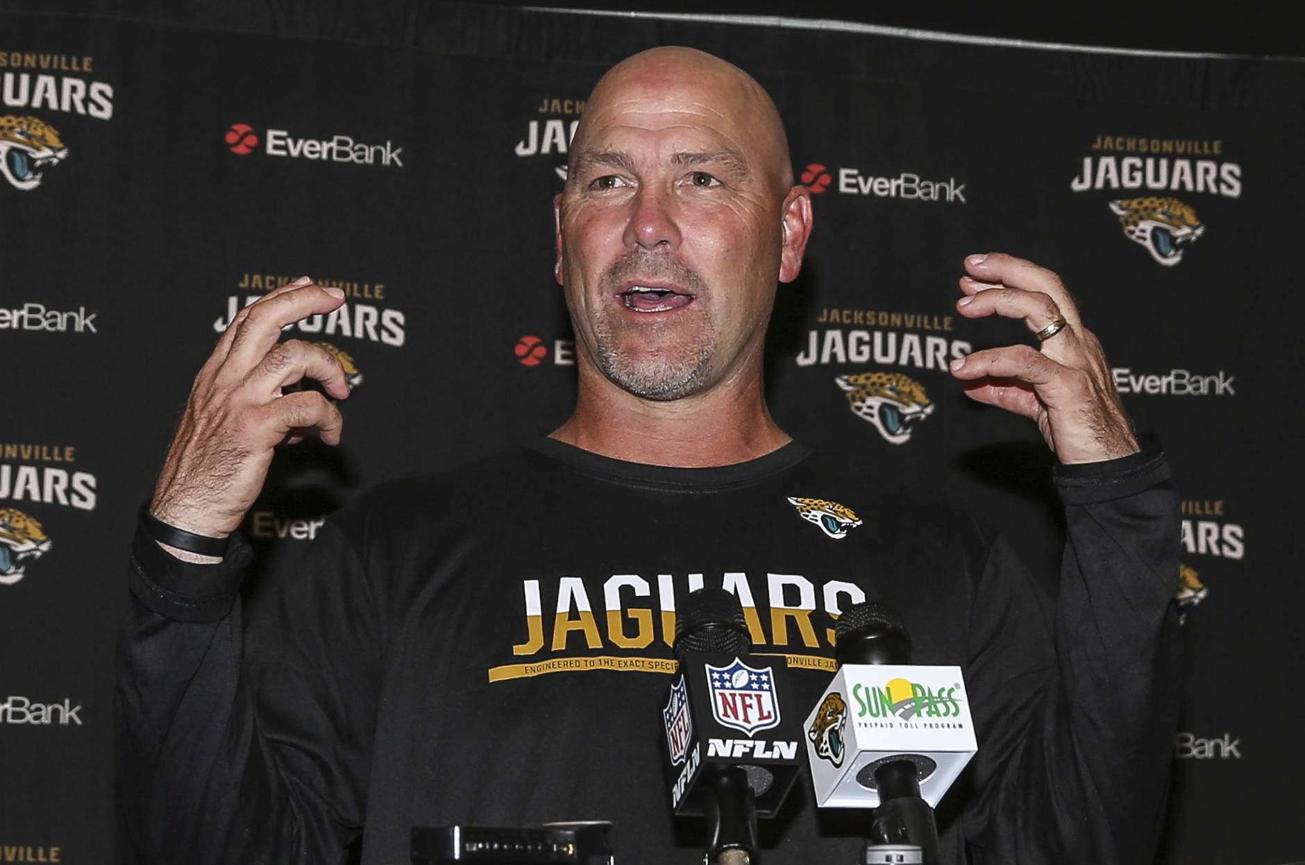 Jacksonville Jaguars head coach Gus Bradley talks to the press after losing an NFL football game to the Denver Broncos 20-10 in Jacksonville, Fla., Sunday, Dec. 4, 2016. (AP Photo/Gary McCullough)