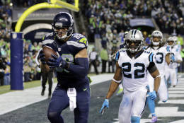 Seattle Seahawks' Jimmy Graham, left, runs for a touchdown after a reception in front of Carolina Panthers' Michael Griffin (22) in the second half of an NFL football game, Sunday, Dec. 4, 2016, in Seattle. (AP Photo/Stephen Brashear)d