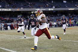 Washington Redskins running back Mack Brown (34) runs for a 61-yard touchdown against the Chicago Bears during the second half of an NFL football game, Saturday, Dec. 24, 2016, in Chicago. (AP Photo/Nam Y. Huh)