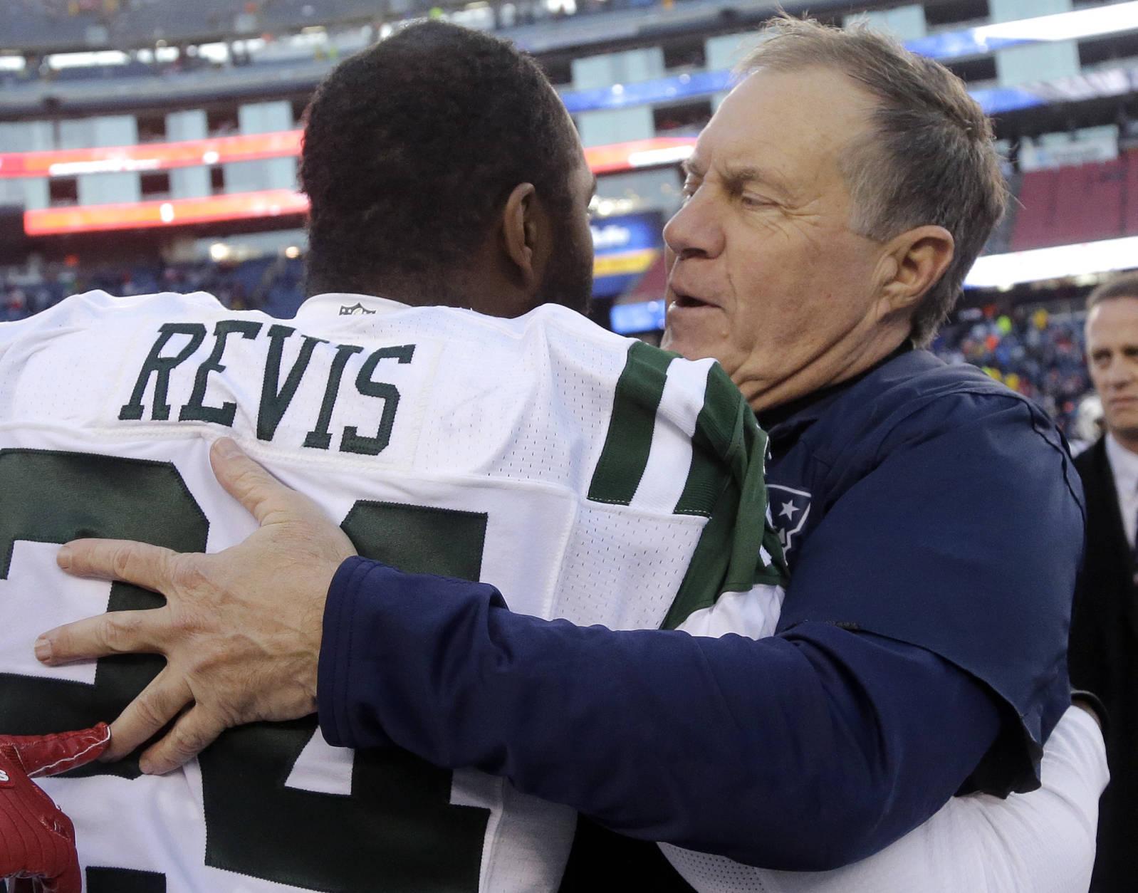 New England Patriots head coach Bill Belichick, right, and New York Jets cornerback Darrelle Revis speak at midfield following an NFL football game, Saturday, Dec. 24, 2016, in Foxborough, Mass. (AP Photo/Elise Amendola)