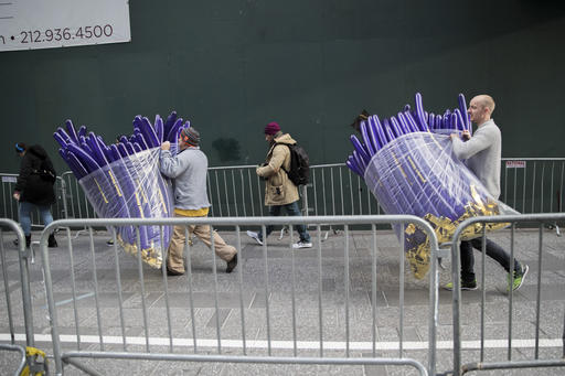 Times Square Business Improvement District workers carry balloons that will be handed out to revelers during the New Years celebration, Friday, Dec. 30, 2016, in New York's Times Square. (AP Photo/Mary Altaffer)