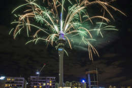 Fireworks explode off Auckland's Sky Tower as the new year is welcomed to New Zealand, Jan 1, 2017. (Peter Meecham/New Zealand Herald via AP)