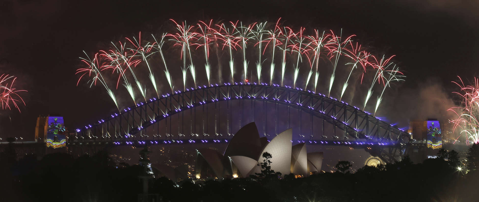 Fireworks explode over the Sydney Opera House and Harbour Bridge as New Year's celebrations are underway in Sydney, Australia, Sunday, Jan. 1, 2017. (AP Photo/Rick Rycroft)