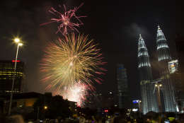 Fireworks explode in front of Malaysia's landmark building, Petronas Twin Towers, during the New Year's Eve celebration in Kuala Lumpur, Malaysia, early Sunday, Jan. 1, 2017. (AP Photo/Lim Huey Teng)