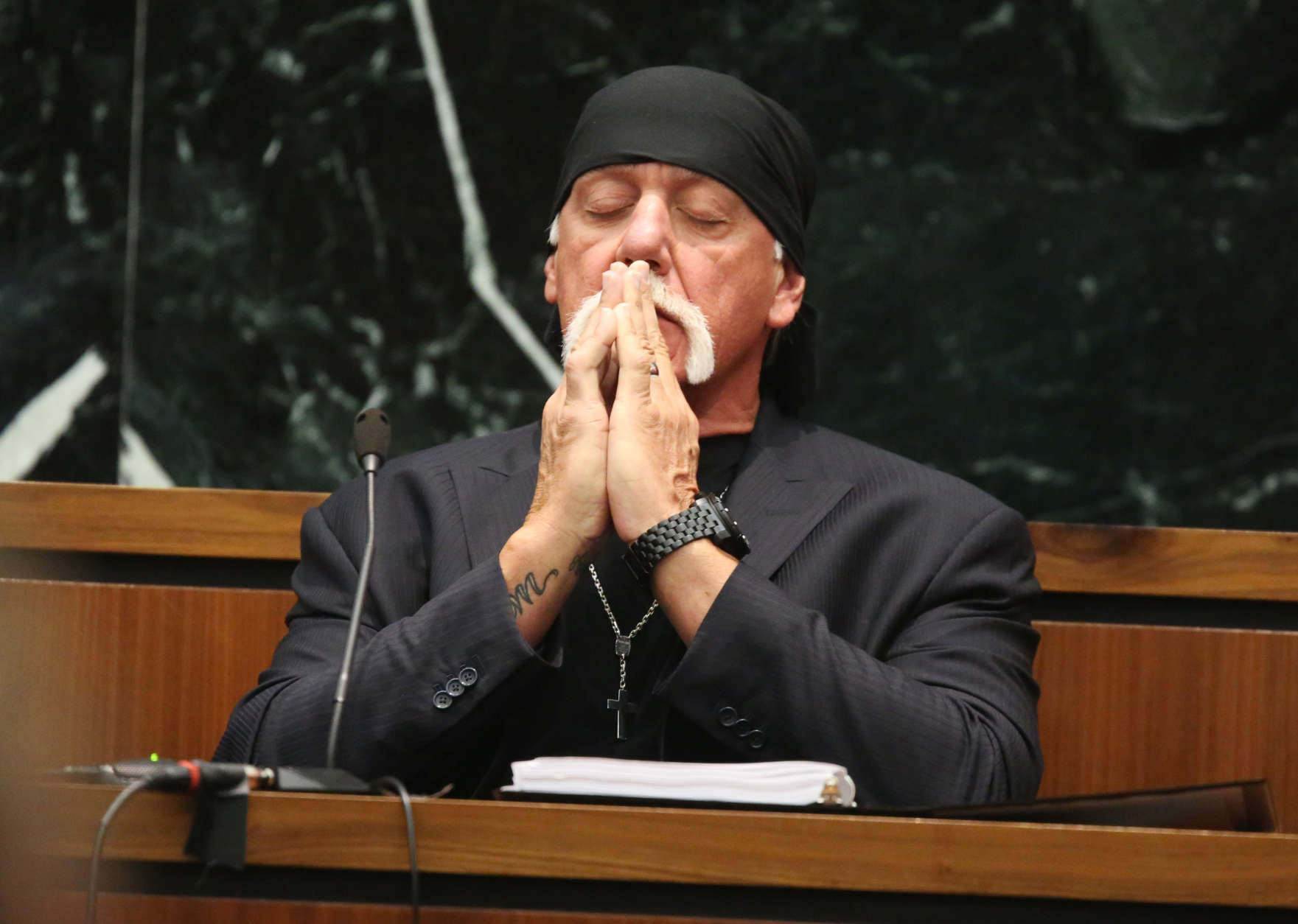 Hulk Hogan, whose given name is Terry Bollea, takes a moment as attorneys talk to the judge in court on Tuesday, March 8, 2016, during his trial against Gawker Media, in St Petersburg, Fl. Hogan and his attorneys are suing Gawker for $100 million, saying that his privacy was violated, and he suffered emotional distress after Gawker posted one minute and forty one seconds of a sex tape filmed of Hogan and his then-best friend's wife. (John Pendygraft/Tampa Bay Times via AP, Pool) MANDATORY NY POST OUT