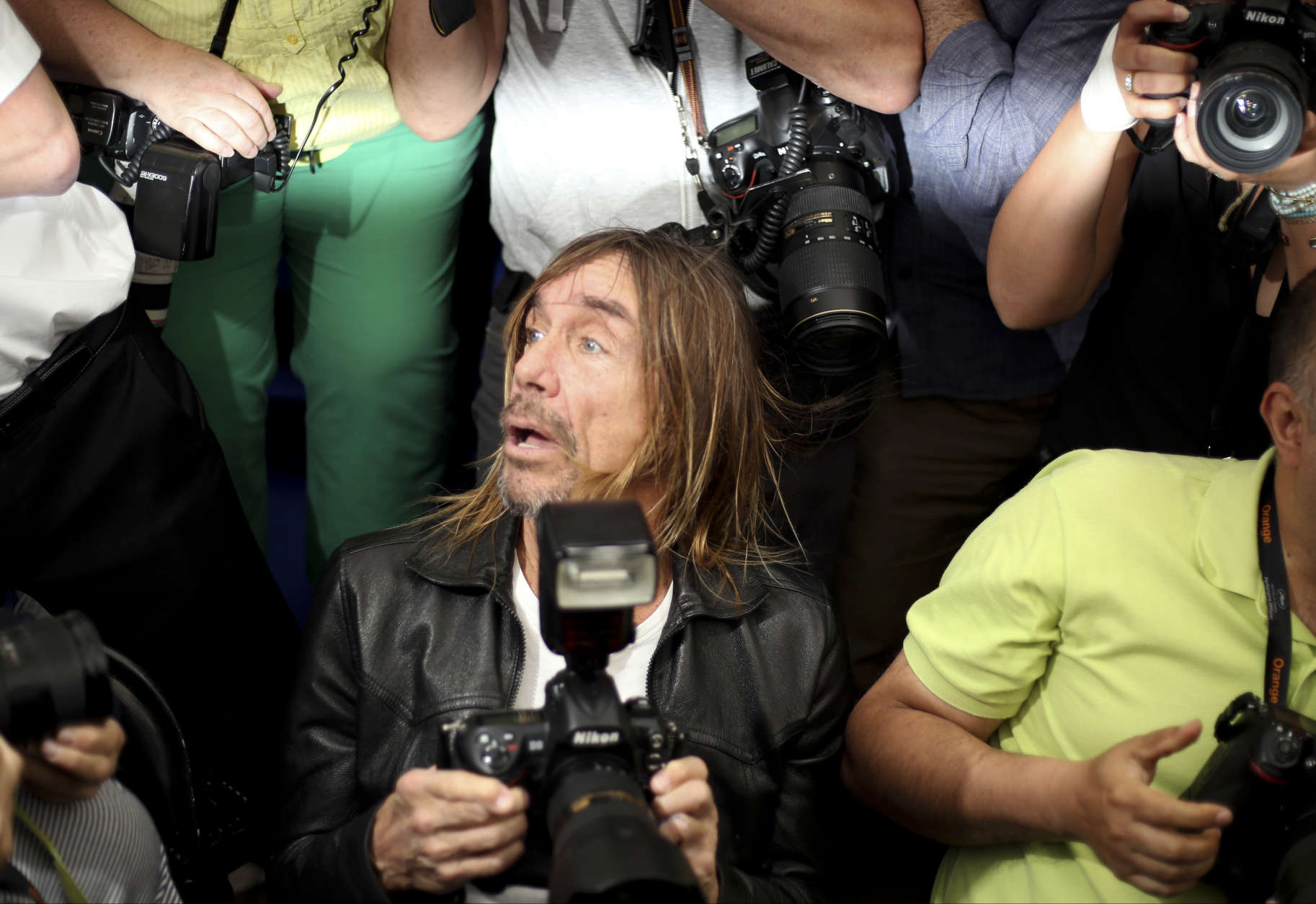 Singer Iggy Pop poses for photographers during a photo call for the film Gimme Danger at the 69th international film festival, Cannes, southern France, Thursday, May 19, 2016. (AP Photo/Joel Ryan)