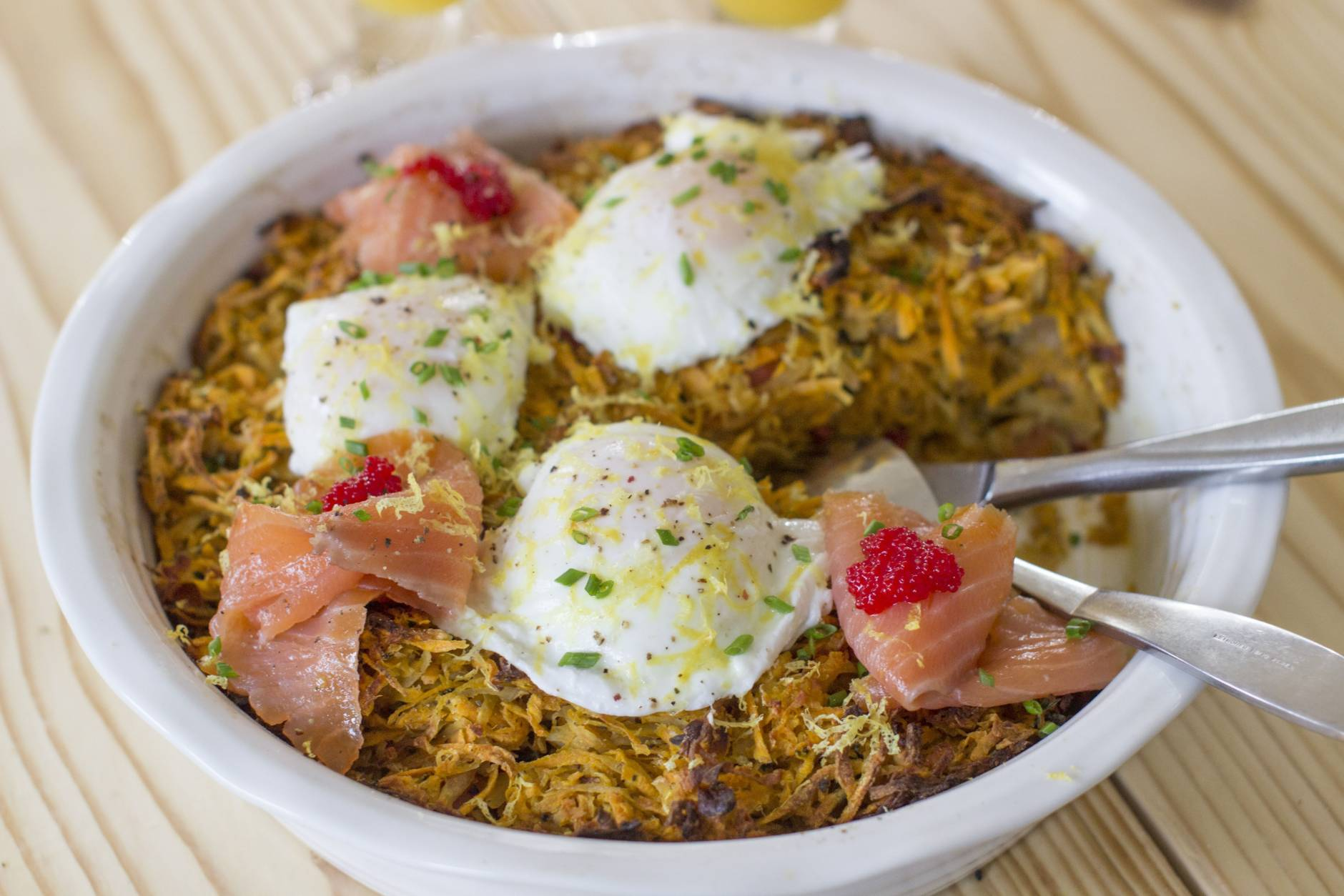 This Nov. 17, 2014 photo shows sweet potato and salmon hash bake in Concord, N.H. This dish can be baked the day before, then reheated in a 350 F oven for 15 to 20 minutes. (AP Photo/Matthew Mead)