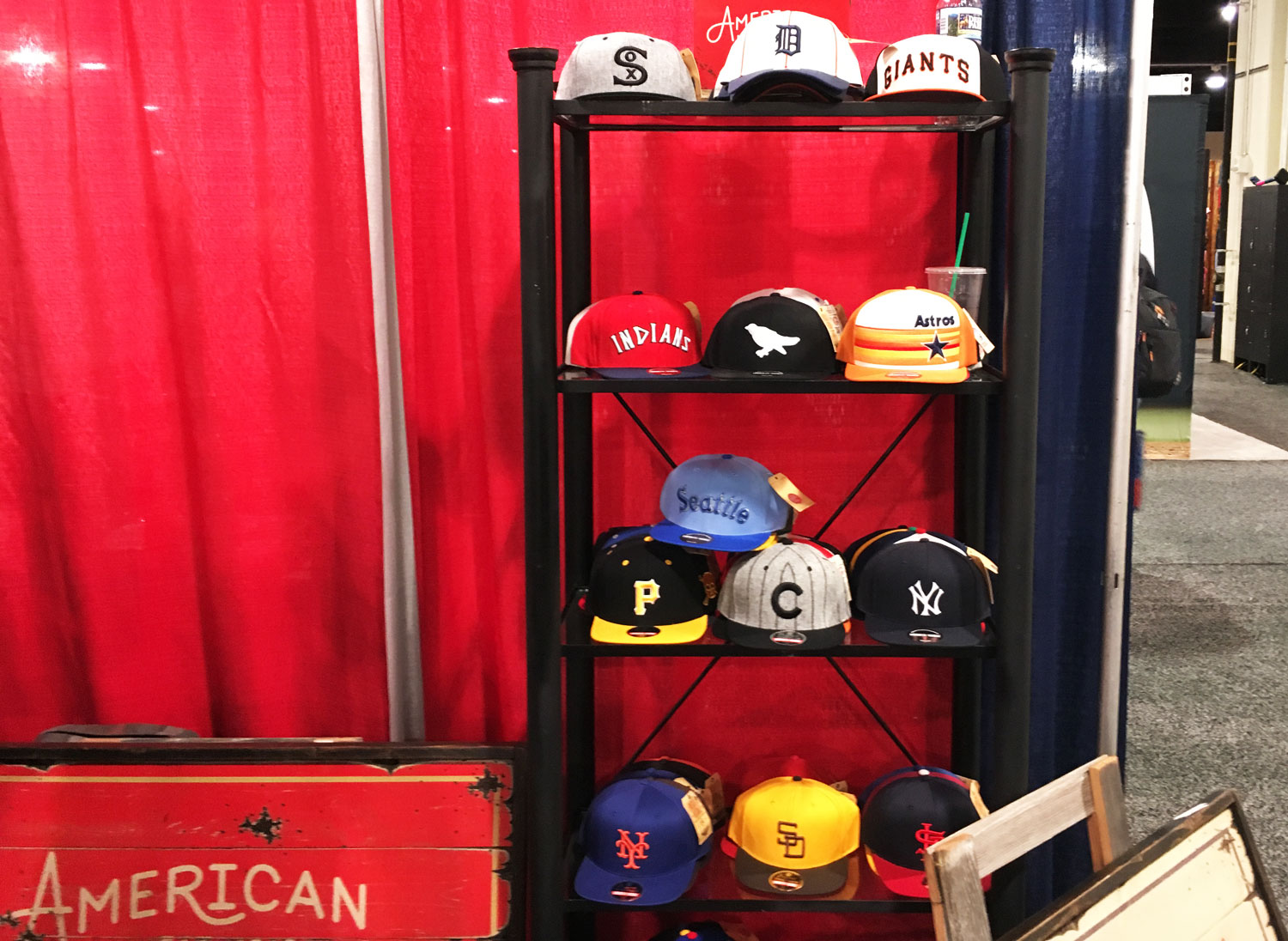 Apparel offerings from American Needle, one of the oldest companies set up at the Trade Show. (WTOP/Noah Frank)
