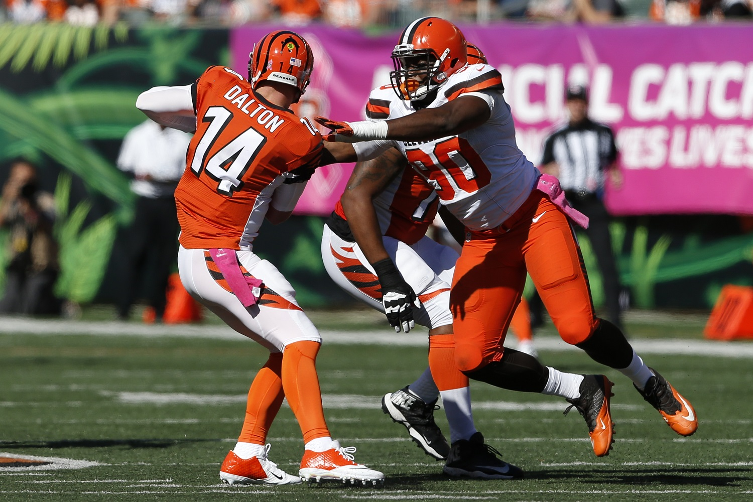 Cincinnati Bengals quarterback Andy Dalton (14) is sacked by Cleveland Browns outside linebacker Emmanuel Ogbah (90) in the first half of an NFL football game, Sunday, Oct. 23, 2016, in Cincinnati. (AP Photo/Gary Landers)