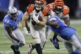 Cincinnati Bengals running back Rex Burkhead (33) carries the ball against the Detroit Lions in the second half of an NFL preseason football game in Detroit, Thursday, Aug. 18, 2016. (AP Photo/Duane Burleson)