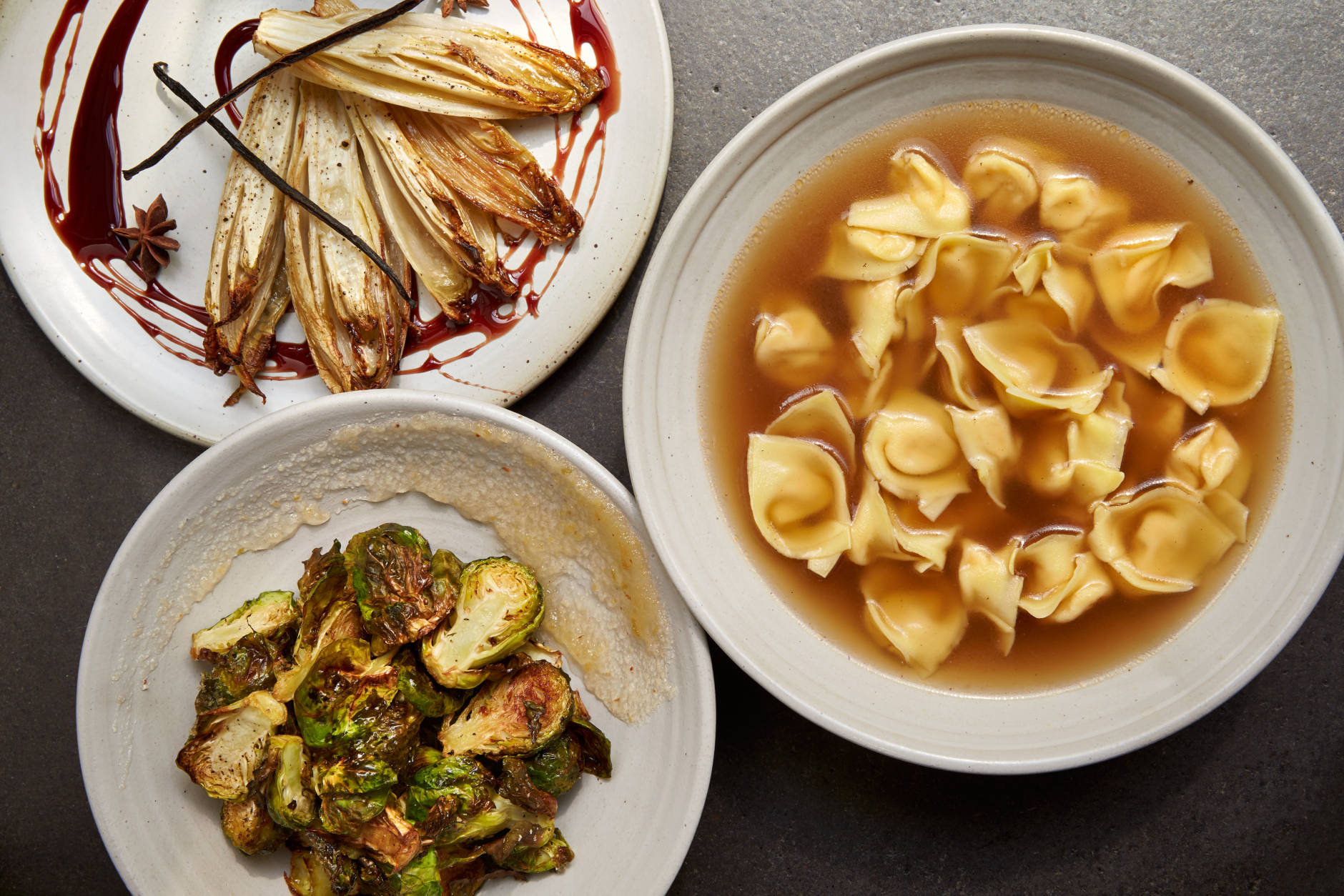 Vanilla-baked endive and pomegranate; roasted Brussels sprouts with apple marmellata; and three meat tortellini in broth on Amy Brandwein's Centrolina holiday catering menu. (Courtesy Centrolina)