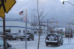 Cars and trucks make their way down South Park Ave. in Buffalo, N.Y., on a 10-degree morning, Thursday, Dec. 15, 2016. City schools and businesses were open as usual after several inches of wind-driven snow snarled the evening commute. (AP Photo/Carolyn Thompson)