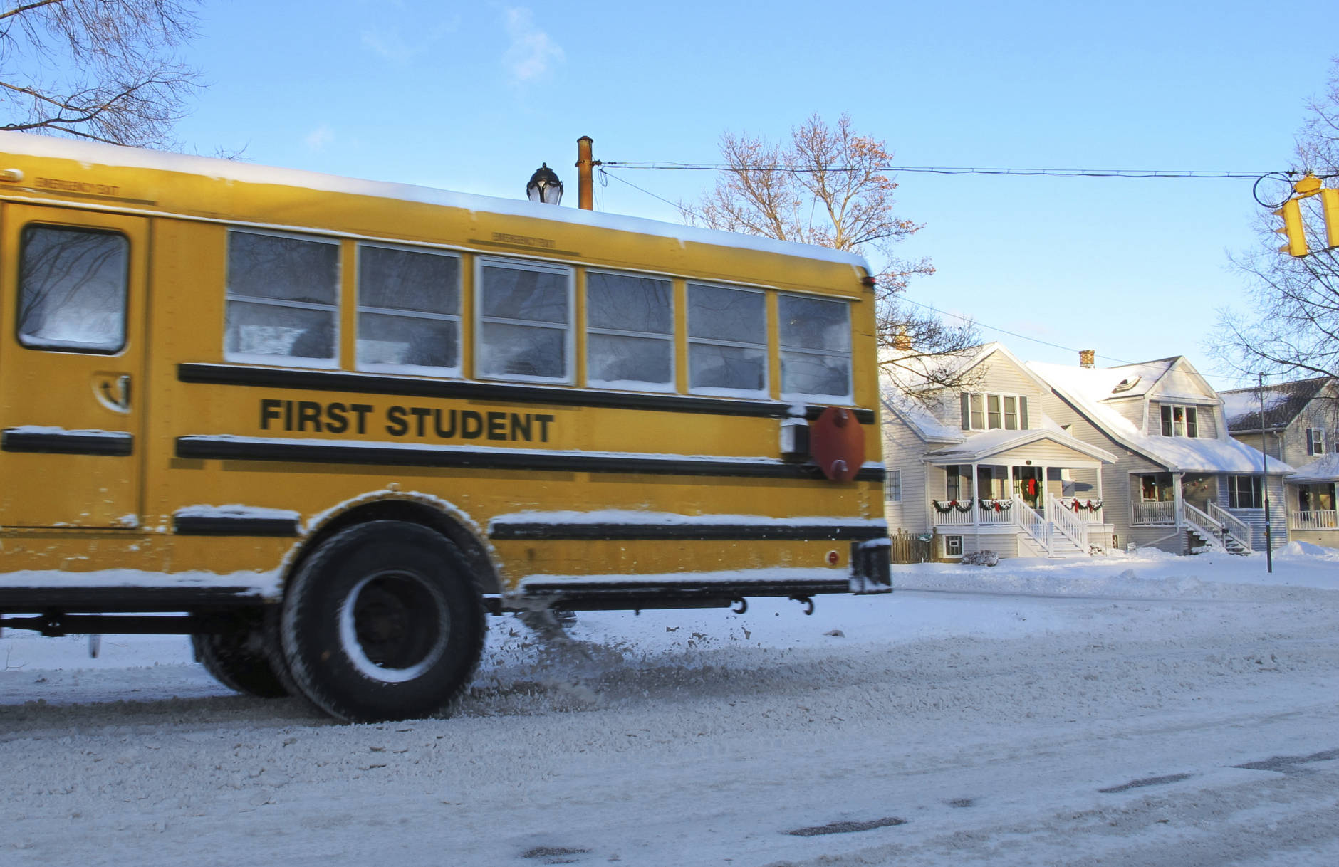 A school bus navigates snow-covered roads on a 10-degree morning in Buffalo, N.Y., Thursday, Dec. 15, 2016. City schools and businesses were open as usual after several inches of wind-driven snow snarled the evening commute. (AP Photo/Carolyn Thompson)