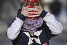 Tabytha Berry, a senior at Altoona Area High School ,adjusts her cap trying to keep the 15 degree temperature from her face, while walking home after school Thursday, Dec. 15, 2016, in Altoona, Pa. (J.D. Cavrich/Altoona Mirror via AP)