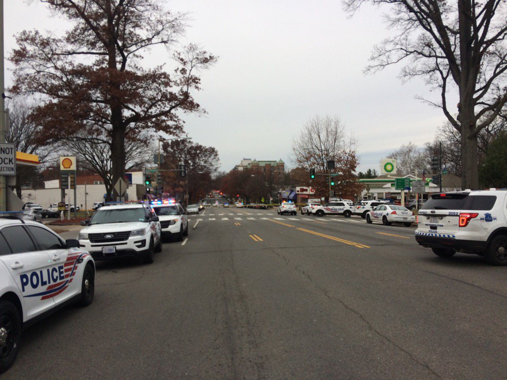 Police close a portion of Connecticut Avenue due to reports of a man with a gun. (WTOP/Dick Uliano)
