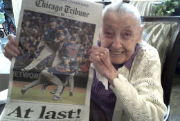 "In this Nov. 4, 2016 photo provided by the Strobel Family, Cubs fan Helen Weithman, celebrates the Chicago Cubs World Series victory at her home in Glen Ellyn, Ill. A lifelong Cubs fan Weithman, 98, who according to family was slipping away until the Cubs made it to The World Series, ""She really came alive when it started and they had the Cubs games on,"" said the daughter, Kathleen Strobel. Weithman died on Nov. 29, 2016 after finally seeing the Cubs win the series for first time in her lifetime. (Photo Courtesy of the Strobel Family via AP)"