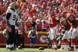 Kansas City Chiefs offensive lineman Mitch Morse (61) stands over the ball at the line of scrimmage during the first half of an NFL football game against the New Orleans Saints in Kansas City, Mo., Sunday, Oct. 23, 2016. (AP Photo/Jeff Roberson)
