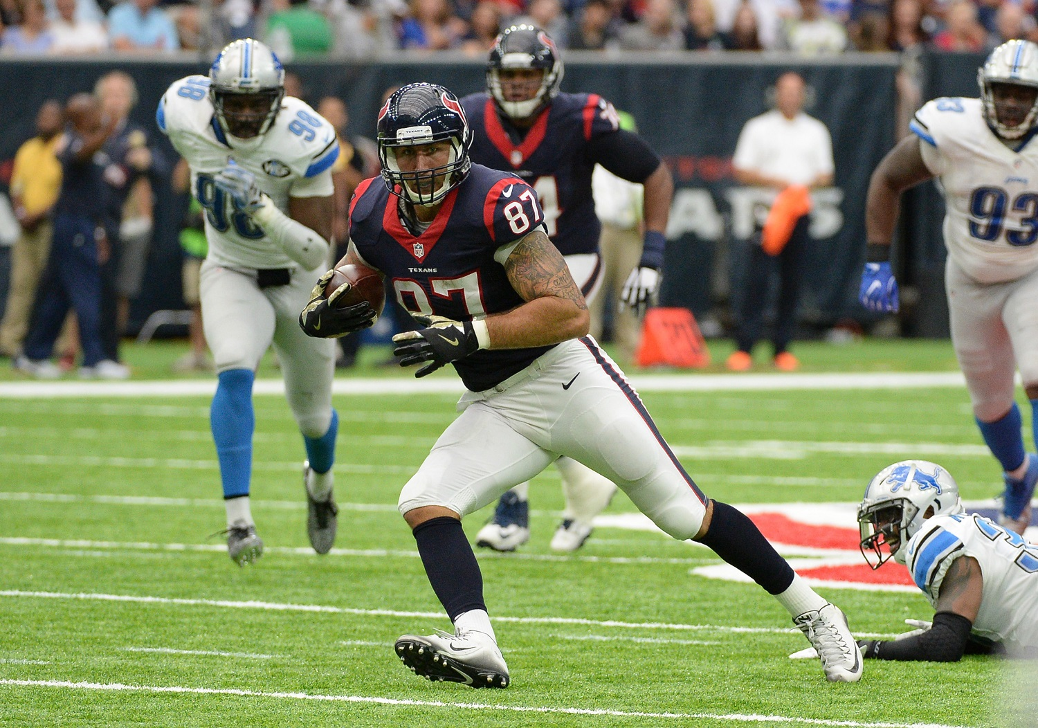 Houston Texans tight end C.J. Fiedorowicz (87) runs past Detroit Lions defender Tavon Wilson (32) during the first half of an NFL football game Sunday, October, 30, 2016, in Houston. (AP Photo/George Bridges)