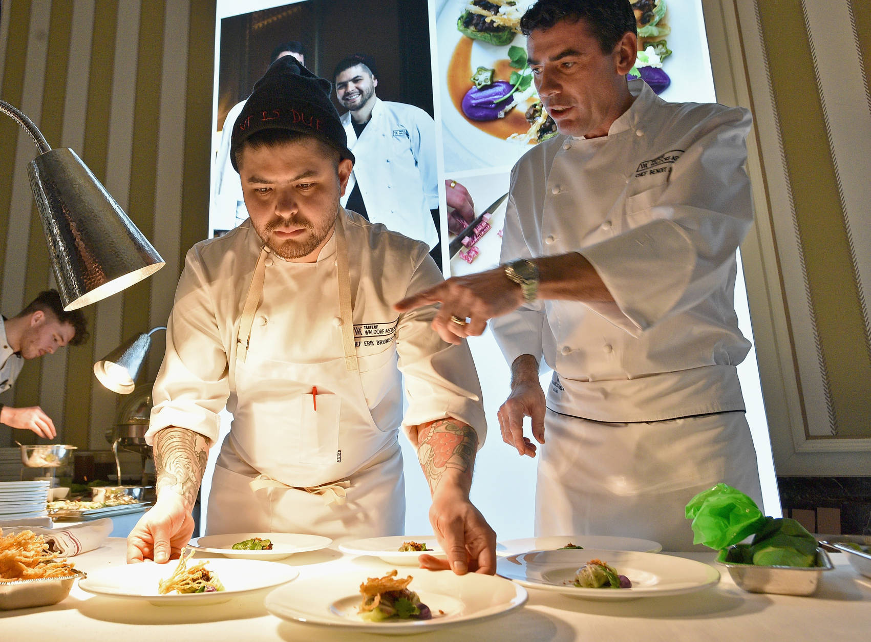 Chefs Erik Bruner-Yang (L) and Benoit Chargy prepare food during Taste of Waldorf Astoria at Waldorf Astoria Hotel on February 23, 2016 in New York City.  (Photo by Bryan Bedder/Getty Images for Waldorf Astoria Hotels & Resorts)