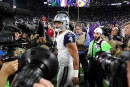 MINNEAPOLIS, MN - DECEMBER 1: Dak Prescott #4 of the Dallas Cowboys is surrounded by cameras after the game against the Minnesota Vikings on December 1, 2016 at US Bank Stadium in Minneapolis, Minnesota. The Cowboys defeated the Vikings 17-15. (Photo by Adam Bettcher/Getty Images)