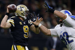NEW ORLEANS, LA - DECEMBER 04: Haloti Ngata #92 of the Detroit Lions pressures Drew Brees #9 of the New Orleans Saints during the first half of a game at the Mercedes-Benz Superdome on December 4, 2016 in New Orleans, Louisiana.  (Photo by Jonathan Bachman/Getty Images)