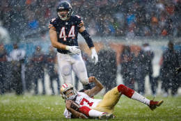 CHICAGO, IL - DECEMBER 04:   Quarterback Colin Kaepernick #7 of the San Francisco 49ers lays in front of  Nick Kwiatkoski #44 of the Chicago Bears in the third quarter at Soldier Field on December 4, 2016 in Chicago, Illinois.  (Photo by Joe Robbins/Getty Images)