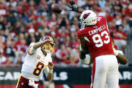 GLENDALE, AZ - DECEMBER 04:  Calais Campbell #93 of the Arizona Cardinals leaps to block the pass of quarterback Kurk Cousins #8 of the Washington Redskins during the first quarter of a game at University of Phoenix Stadium on December 4, 2016 in Glendale, Arizona.  (Photo by Ralph Freso/Getty Images)